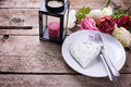 Decorative white  heart, knife and fork on white plate on vintag Royalty Free Stock Photo