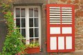 Decorative wooden window with shutters and flowers in monreal eifel rhineland palatinate germany Stock Photo