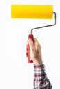 Decorator holding a painting roller s male hand on white background hobby and home renovation concept Stock Images