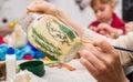 Decoupage bottle professional painter paints a souvenir Stock Photos