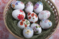 Decoupage eggs group of colorful easter decorate with flowers made by technique in basket Stock Photos