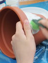 Decoupage on flower pot hands of a child masters getting started Stock Photos