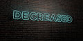 DECREASED -Realistic Neon Sign on Brick Wall background - 3D rendered royalty free stock image Royalty Free Stock Photo