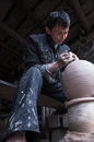 A dedicated chinese potter was making traditional pot for wine in his workshop Royalty Free Stock Photography