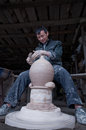 A dedicated chinese potter was making traditional pot for wine in his workshop Royalty Free Stock Image