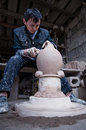 A dedicated chinese potter was making traditional pots for wine and other uses he was very Royalty Free Stock Photography