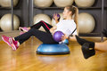 Photo : Dedicated woman trains abdominal exercise for core strength men hearth problem
