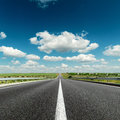 Deep blue cloudy sky over road asphalt Royalty Free Stock Photography