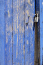 Deep blue rusty wicket door with metal handle and lock Royalty Free Stock Photo