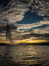 Unique circular cloud pattern over the harbour of Geneva, Switzerland. Royalty Free Stock Photo