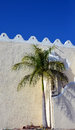 Deep blue sky and roof detail on church in merida mexico with palm tree Royalty Free Stock Images