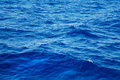 Deep blue water background in blue. Royalty Free Stock Photo