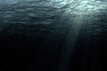 Deep dark ocean waves from underwater background Royalty Free Stock Photo
