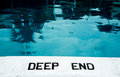 The deep end text on side of a pool informing that this is Royalty Free Stock Photography