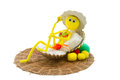 Deep etched pipe cleaner doll in a bikini yellow an orange and green with hat Stock Images