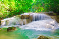 Deep forest waterfall at erawan waterfall national park kanjanaburi thailand Royalty Free Stock Images