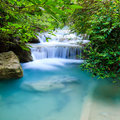 Deep forest waterfall at erawan waterfall national park kanjanaburi thailand Stock Photos