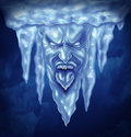 Deep freeze and extreme cold weather concept as a group of icicles in the shape of an intense frozen human expression made of ice Royalty Free Stock Photos