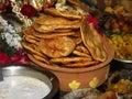 Deep fried chapatti, poori, pancake,served in mud bowl Royalty Free Stock Photo