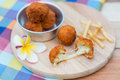 Deep fried cheese ball and french fries on wood dish Royalty Free Stock Photo