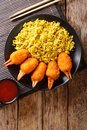 Deep fried crab claws in breadcrumbs of surimi with spicy yellow