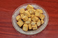 Deep fried of cube soft tofu in glass dish on wood. Top view. Royalty Free Stock Photo
