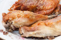 Deep fried drumstick and thigh on a white plate Royalty Free Stock Photography