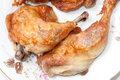 Deep fried drumstick and thigh on a white plate Stock Photos