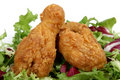 Deep fried spring chicken in golden lemon batter with salad Stock Image