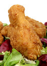 Deep fried spring chicken in golden lemon batter with salad Royalty Free Stock Photos