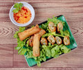 Deep fried spring roll  as four sheet wrap  fried vermicelli and sliced cabbage in roll bar to deep fried. Royalty Free Stock Photo