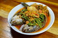 Deep fried striped snake head fish in mixed hot and sour soup on dish the Royalty Free Stock Photos