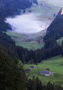 Deep green valley with lake, Switzerland Stock Photo