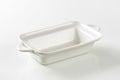 Deep rectangular white ceramic dish with handles Royalty Free Stock Photos