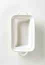 Deep rectangular white ceramic dish with handles Stock Photo