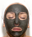Deep sea mud mask treatment Stock Photo