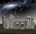 Deep space observation at stonehenge the monument of in front of a primordial Royalty Free Stock Photo