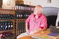 Deep toughts next to wine elderly man thinking a glass of rose in a winery Stock Photo