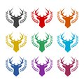 Deer head with big antlers in laurel wreath icon, color set Royalty Free Stock Photo