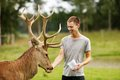 image photo : Deer with man