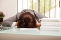 Defeated business woman just gave up on her deadline of too many documents to review at work Royalty Free Stock Photos