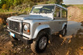 Defender in off road the image depicts an jeep who has passed a large puddle of water and mud Stock Image