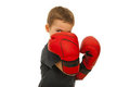 Defending little boy with boxing gloves Royalty Free Stock Photo
