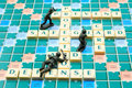 Defense concept scrabble words with toy soldiers Royalty Free Stock Photo