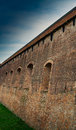 Defense wall old city provided with holes for artillery like cannons Royalty Free Stock Photos