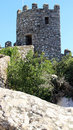 Defensive tower castle of the moors is located in mountain range Stock Photos
