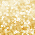 Deficused golden bokeh background with sparkles Royalty Free Stock Photos