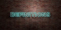 DEFINITIONS - fluorescent Neon tube Sign on brickwork - Front view - 3D rendered royalty free stock picture Royalty Free Stock Photo