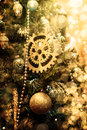 Defocus christmas background xmas with golden decorationsl on branches of fir tree Stock Photos