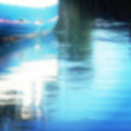 Defocused blue boat reflecting in water Royalty Free Stock Photo